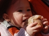 Eating a muffin the size of her head